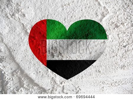 Love United Arab Emirates flag sign heart symbol on Cement wall texture background design poster