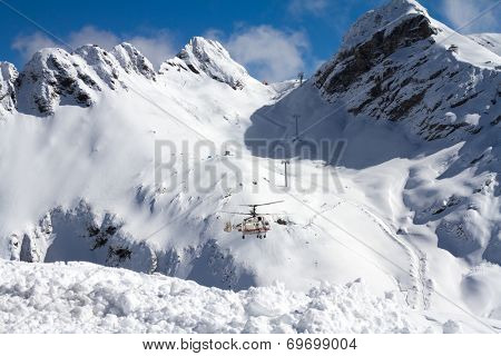 ski resort in the mountains, ski lift and helicopter poster