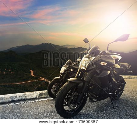 Big Bike ,motorcycle Parking On Top Of Mountain With Sun Light On Evening Sky Background Use For Spo