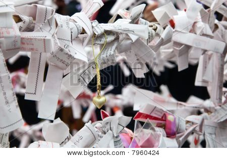Japanese  omikuji paper fortunes at a Japanese shinto shrine.