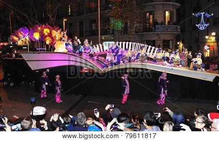 BARCELONA, SPAIN - JANUARY 5: The Cavalcade of Magi on January 5, 2015 in Barcelona, Spain. The Magi and their servants parade in floats by the main streets of the city