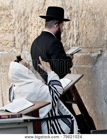 JERUSALEM, ISRAEL - OCTOBER 31, 2014: Two orthodox Jewish men praying at the Western Wall.