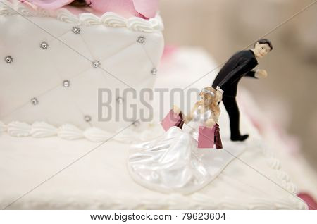 Bride And Groom Cake Toppers On A Wedding Cake