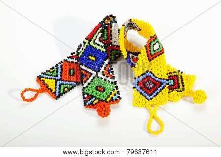 Brightly Colored Zulu Beaded Wristbands In Shape Of Aids Ribbons