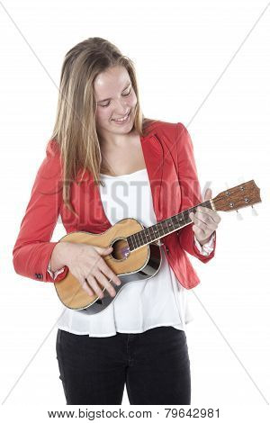 Teenage Girl Plays Ukelele In Studio Against White Background