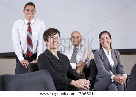 Mature Hispanic Businesswoman Leading Office Team
