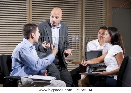 Manager Talking With Group Of Office Workers