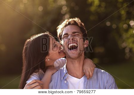 Young Woman Biting Her Boyfriend's Ear