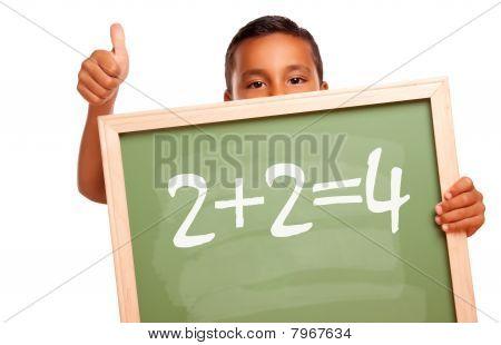 Proud Hispanic Boy Holding Chalkboard With Math Equation