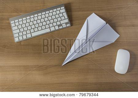 Paper Plane On An Office Desk