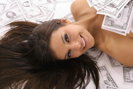 woman covered in money