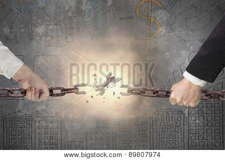 Businessman Pulling Rusty Iron Chains Broken With Business Doodles Wall