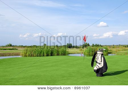 golf field with golf bag