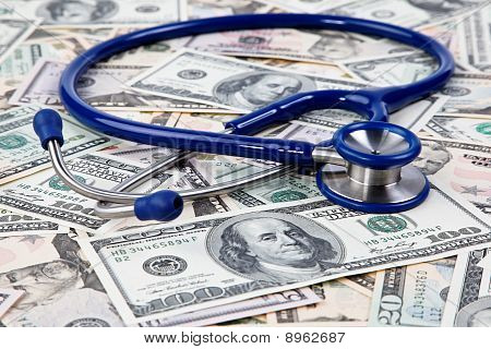 Dollar Bills And Stethoscope
