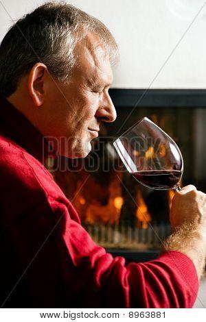 Man drinking red wine