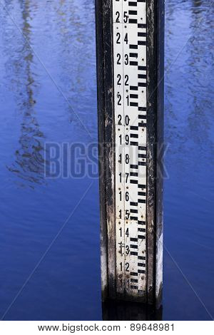 Water level measurement gauge used to monitor the water levels. Water level measurement gauge during flood. poster