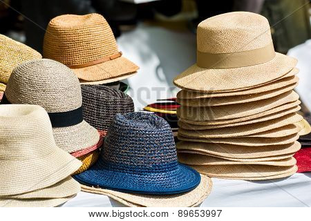 Pile Of Hats On Market Stand