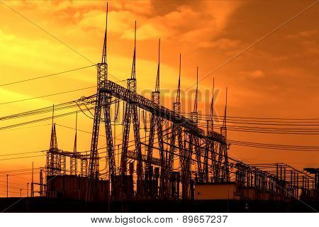 High voltage power transformer substation, sunset