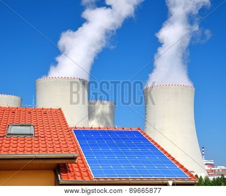 Solar panel on the roof of the house in the background nuclear power plant.