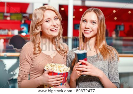 Two girls with drink and popcorn