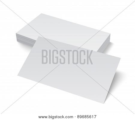 Stack of blank business card on white background with shadows.