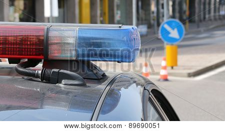 Blue And Red Flashing Sirens Of Police Car In The City