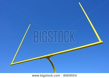 American Football Goal Posts Over Blue Sky