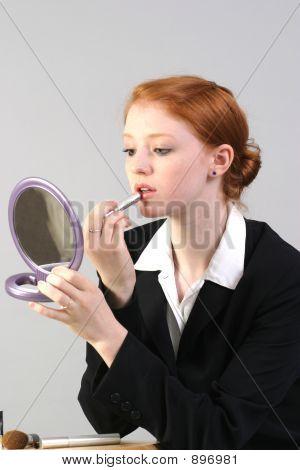 Business Woman Applying Lipstick