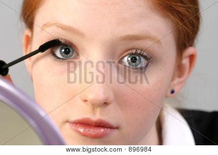 Business Woman Applying Mascara