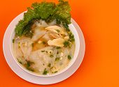 Glass noodle soup with chicken and beansprouts on an orange background poster
