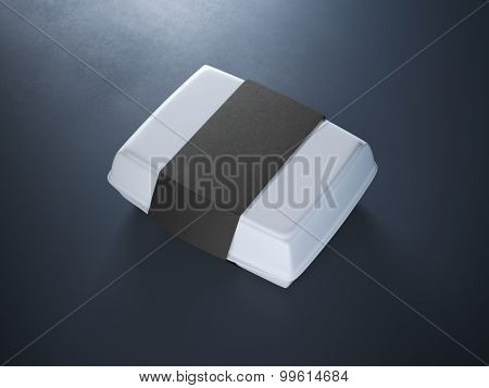White lunch box with black label on the blue floor poster