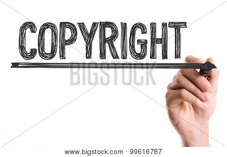 Hand with marker writing the word Copyright