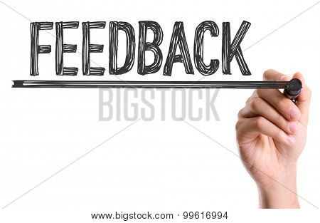 Hand with marker writing the word Feedback