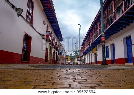 Street angle from quiet city center with beautiful historic town houses at Zipaquira