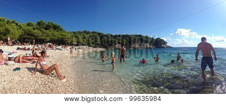 VIS, CROATIA - 21 AUGUST 2015: Srebrena beach on the island of Vis. This beach is famous for its white round pebbles on the beach.