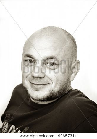 Black and white portrait of ironical smiling man