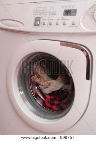 Working Washing Machine With The Clothing Inside