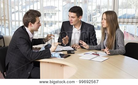 Group of three people having discussion