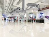 CCTV Security camera shopping department store background. poster