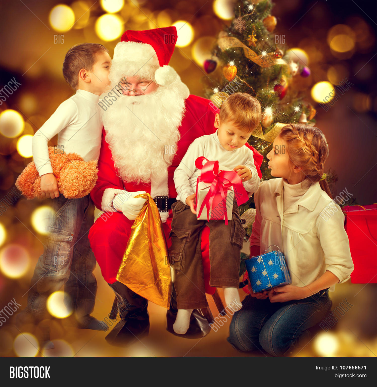 santa claus giving christmas gifts to children santa and happy kids sister and brothers - Santa Claus Children