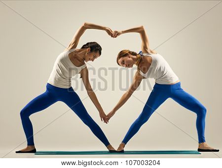 yoga in pair. heart