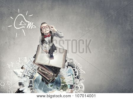 Wideangle picture of funny schoolgirl with paper plane. Elements of this image are furnished by NASA