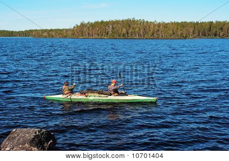 Tourists Float On A Canoe