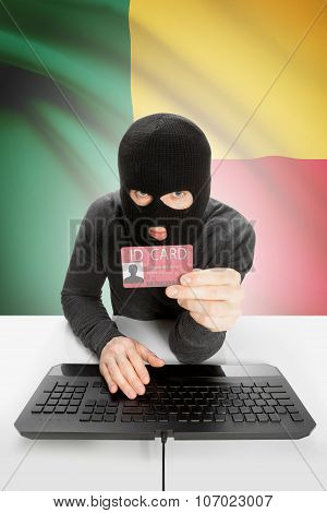 Hacker With Flag On Background Holding Id Card In Hand - Benin