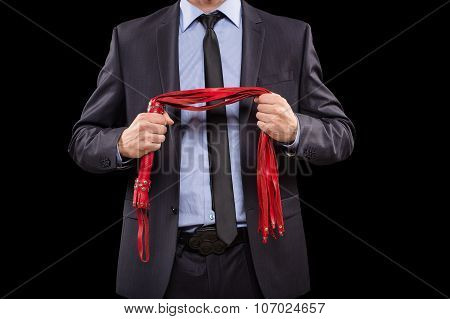 man in business suit with chained hands. handcuffs for sex games