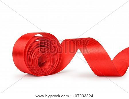 The Unwound Roll Of Red Ribbon Isolated On White Background
