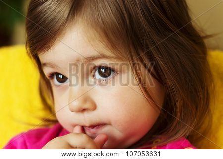 Cute sad little child  with big eyes thinking