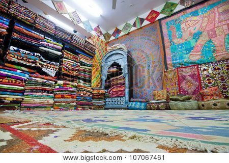 Interior Of The Textile Store With Colorful Carpets, Bedspreads And Shawls For Women In Rajasthan