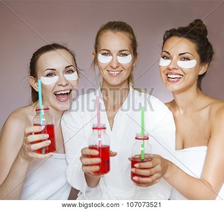 Young Happy Female Friends Drinking Juice In Spa