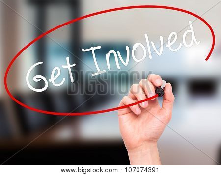 Man Hand writing Get Involved with black marker on visual screen.